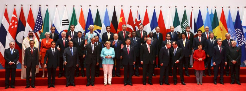 Leaders, including Britain's Prime Minister Theresa May (2nd row, 2nd L), pose for pictures during the G20 Summit in Hangzhou, Zhejiang province